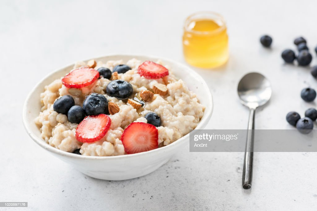 Oatmeal porridge with blueberry, strawberry and almonds