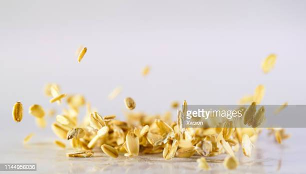 "oats flake dancing captured with high speed sync""n - ground culinary stock photos and pictures"