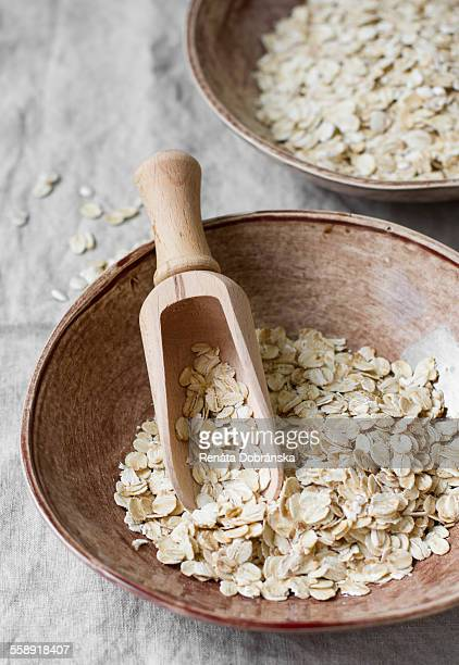 Oats in ceramic bowl with scoop