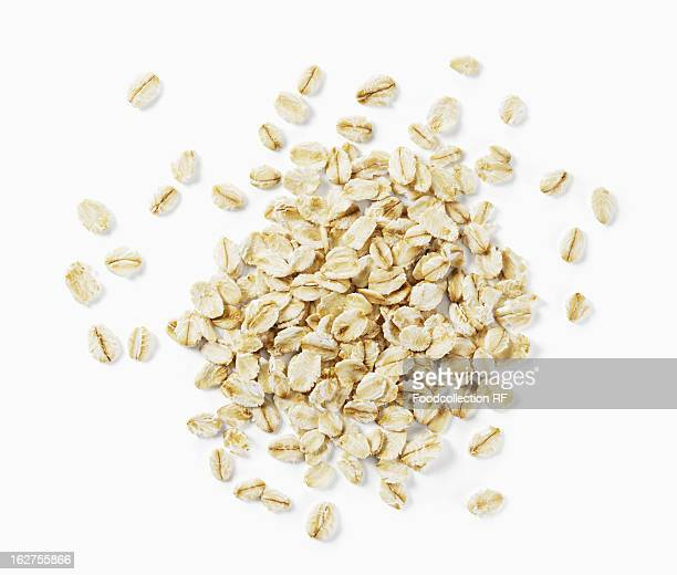 oats on white background - oatmeal stock photos and pictures