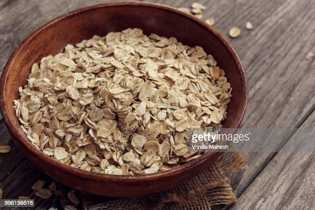 oats - rolled oats stock photos and pictures