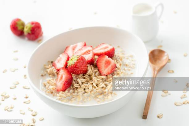 oats porridge with fresh strawberries and milk - rolled oats stock photos and pictures