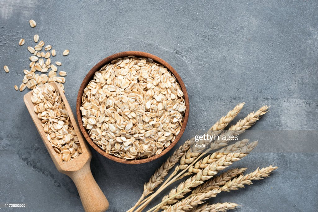 Oats, rolled oats, whole grains : Stock Photo