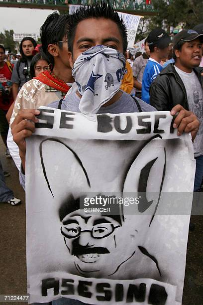 Students marches with thousands of teachers in Oaxaca on June 16th asking for the resignation of Governor Ulises Ruiz after Wednesday's clashes with...
