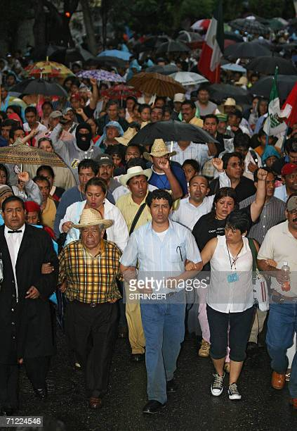 The leader of the National Education Workers? Union , Enrique Rueda Pacheco , marches alongside thousands of teachers in Oaxaca on June 16th...