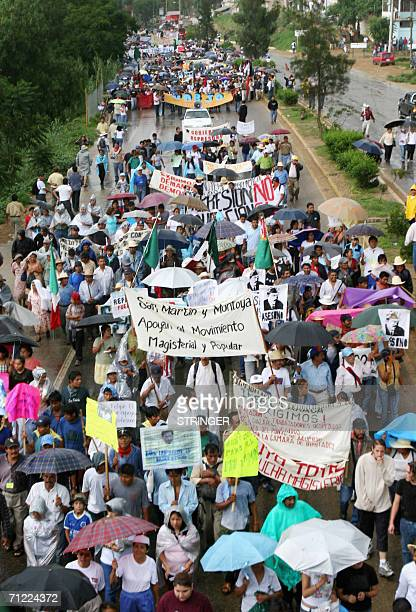 Thousands of teachers of the Mexican state of Oaxaca march along a highway to the center of the city on June 16th, 2006. At dawn on Wednesday some...