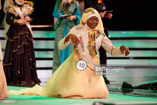Obabiyah Aishah Aijbola World Musimah from Nigeria falls to her knees in prayer after being named World Muslimah 2013 the 3rd annual World Muslimah...