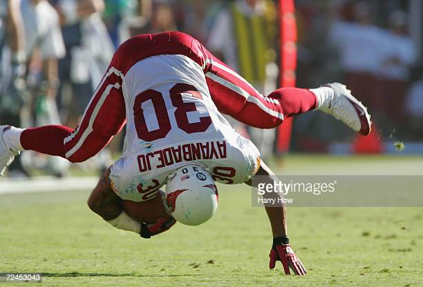 Obafemi Ayanbadejo of the Arizona Cardinals loses his balance against the Seattle Seahawks in the third quarter at Sun Devil Stadium on October 24...