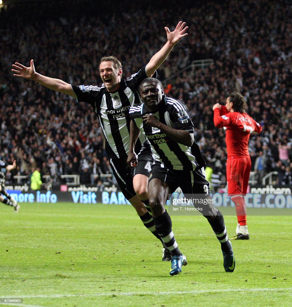 Obafemi Martins and Kevin Nolan celebrate after Martins scored the 2:1 goal during the Barclays Premier League match between Newcastle United and Middlesbrough at St James' Park on May 11, 2009 in Newcastle Upon Tyne, England.