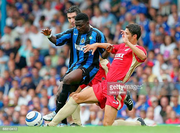 Obafemi Martins of Inter battles with Dejan Stefanovic of Portsmouth during the pre-season friendly between Portsmouth and Internazionale on July 31,...