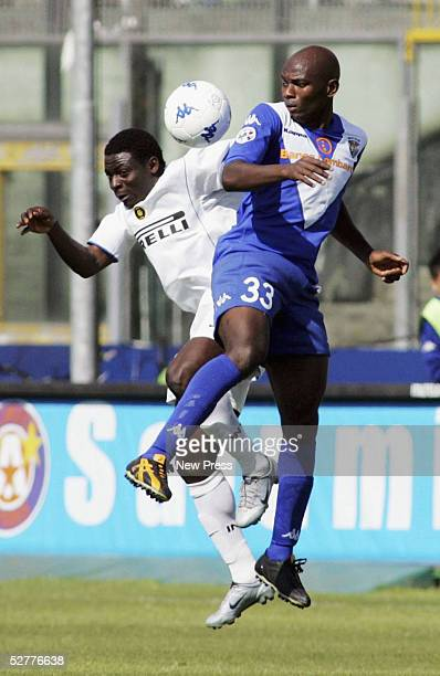 Obafemi Martins of Inter clashes with Pierre Wome of Brescia during the Serie A match between Brescia v Inter Milan played at the Mario Rigamonti...