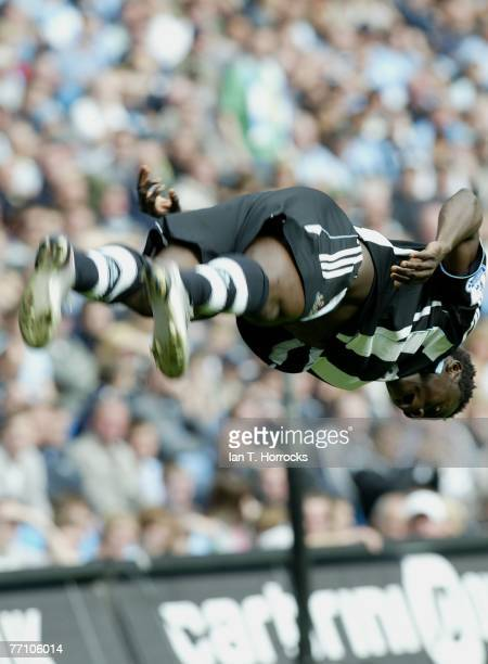 Obafemi Martins of Newcastle celebrates after he scored the opening goal during the Barclays Premier League match between Manchester City and...