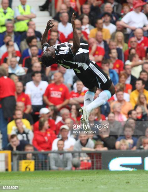 Obafemi Martins of Newcastle United celebrates scoring the first goal during the Barclays Premier League game between Manchester United and Newcastle...