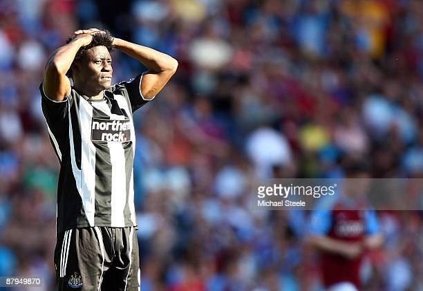 Obafemi Martins of Newcastle United reacts as Newcastle United are relegated from the Premier League after their 10 defeat by Aston Villa at the...