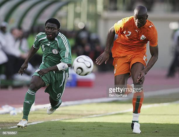 Obafemi Martins of Nigeria and Abdoulaye Meite of Ivory Coast during The African Cup of Nations Semi Final match between Ivory Coast and Nigeria at...