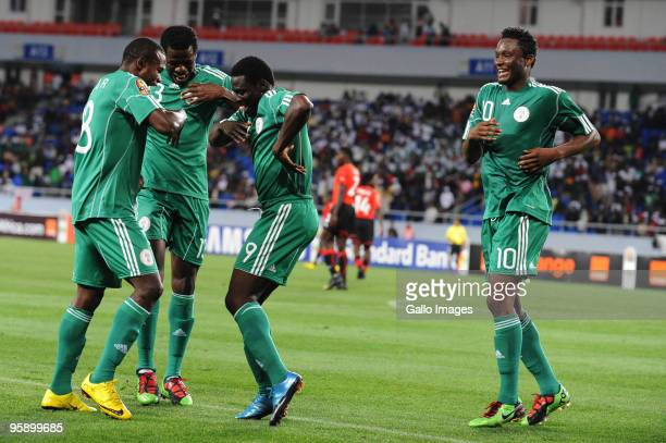 Obafemi Martins of Nigeria celebrates his goal with John Obi Mikel and Obinna Nsofor during the African Nations Cup Group C match between Nigeria and...