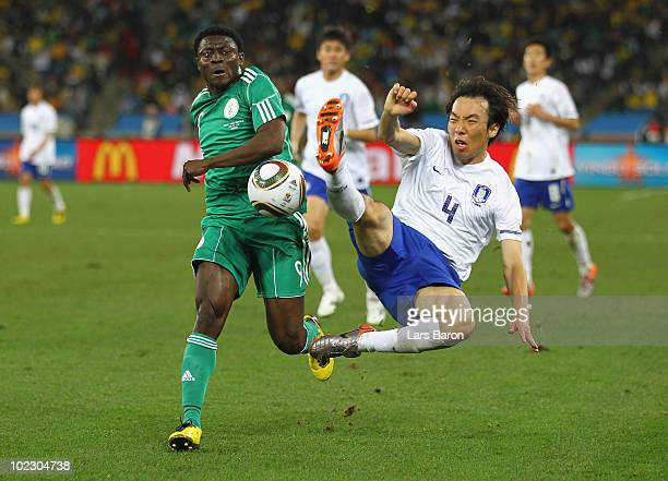 Obafemi Martins of Nigeria is tackled by Cho YongHyung of South Korea during the 2010 FIFA World Cup South Africa Group B match between Nigeria and...