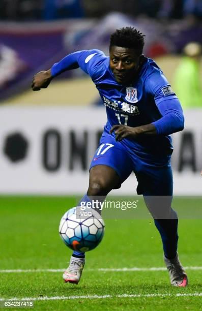 Obafemi Martins of Shanghai Shenhua drives the ball during the AFC Champions League 2017 playoff match between Shanghai Shenhua and Brisbane Roar at...