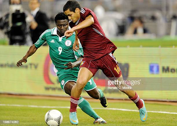 Obafemi Martins of the Nigeria Soccer Team in action during an exhibition game against the Venezuela National Soccer Team at Marlins Park on November...