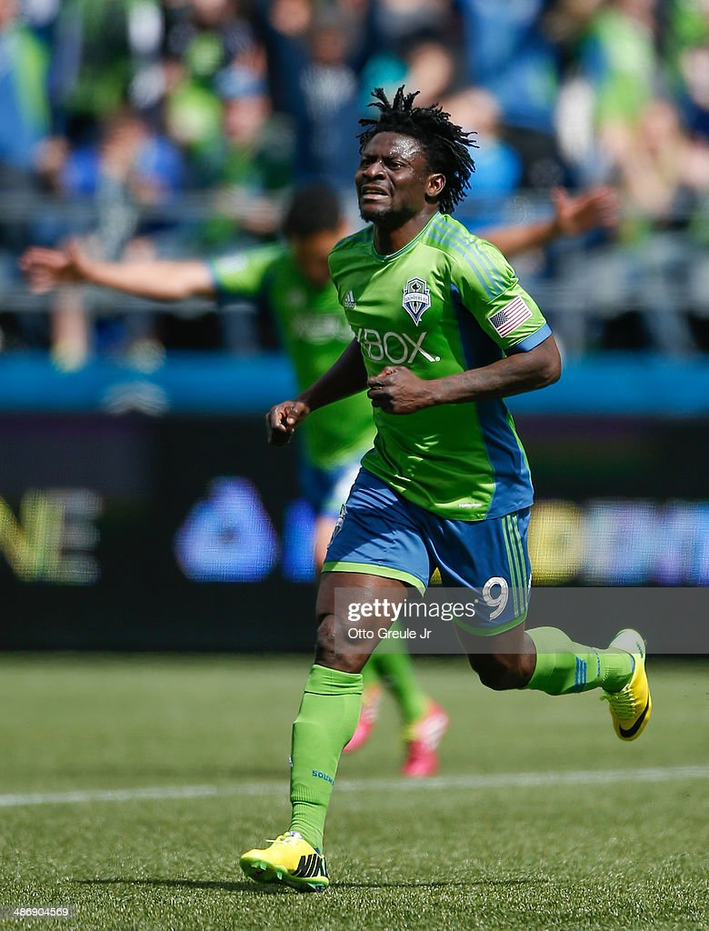 Obafemi Martins #9 of the Seattle Sounders FC reacts after scoring a goal in the second half against the Colorado Rapids at CenturyLink Field on April 26, 2014 in Seattle, Washington. The Sounders defeated the Rapids 4-1.