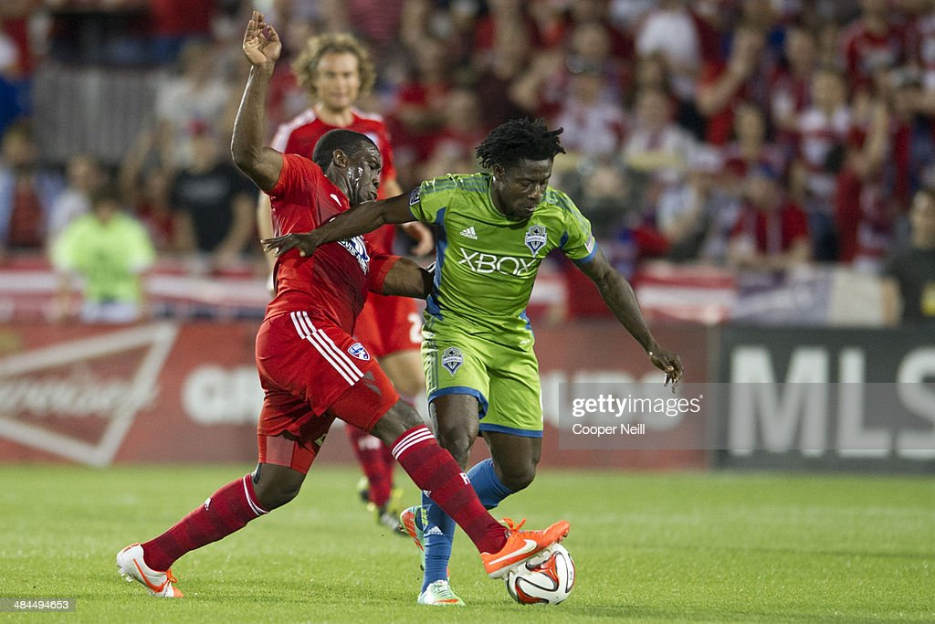 Obafemi Martins #9 of the Seattle Sounders FC shields the ball away from Hendry Thomas #20 of the FC Dallas on April 12, 2014 at Toyota Stadium in Frisco, Texas.