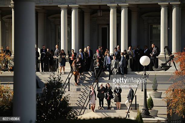 Obama administration employees line the stairs outside the Eisenhower Executive Office Building in hopes of catching a glimpse of PresidentElect...