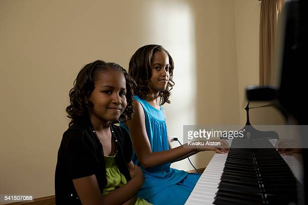 Malia Ann and Sasha Obama