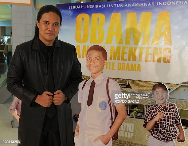 Obama film codirector Damien Dematra stands beside the portrait of 12yearold US actor Hasan Faruq Ali playing role of young US President Barack Obama...