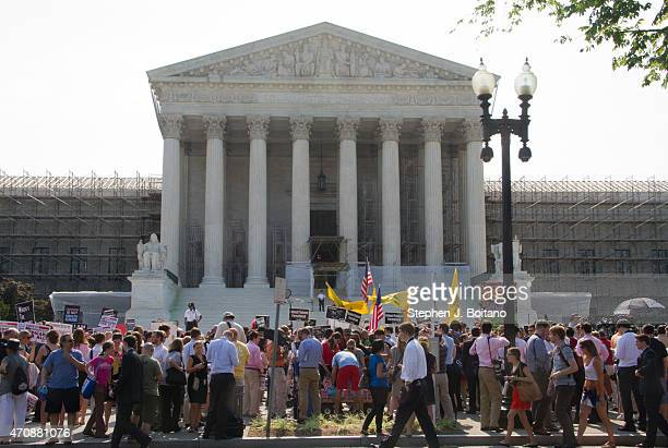 Obamacare supporters and protesters gather in front of the US Supreme Court to find out the ruling on the Affordable Health Act in front of the US...