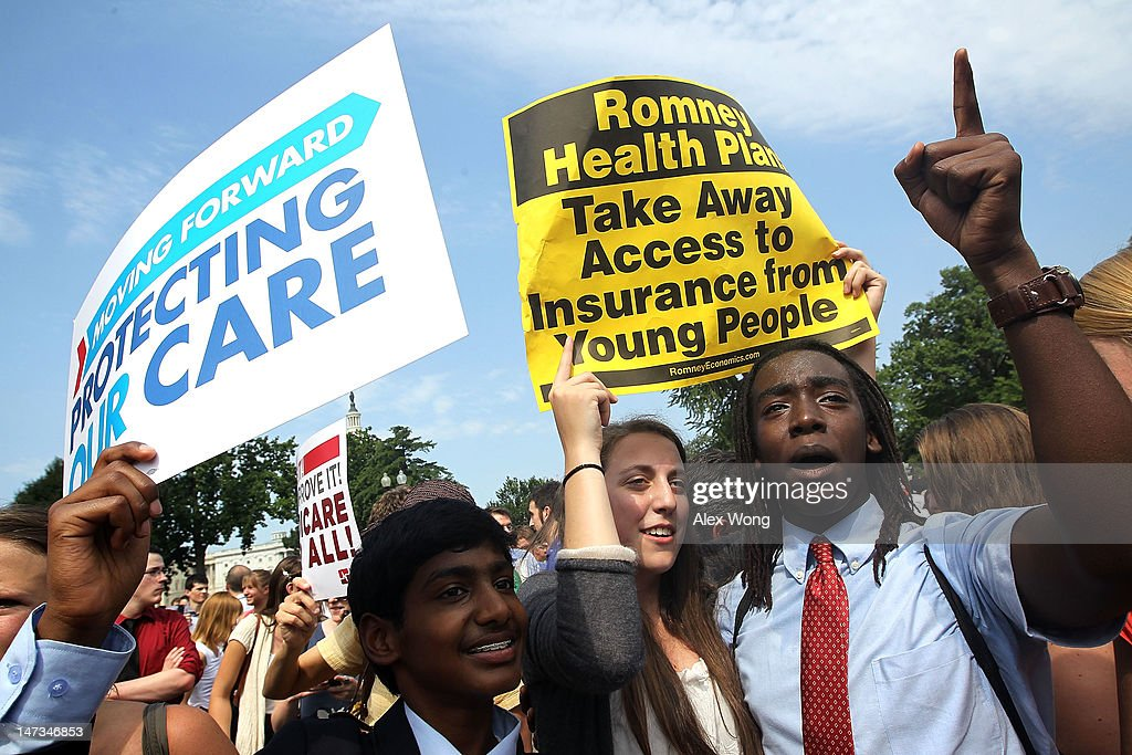 Obamacare supporters, (L-R) Kailash Sundaran of Cupertino, California, Devyn Greenberg of New York City, and Devontae Freeland of Metuchen, New Jersey celebrate as they respond to the Supreme Court ruling on the Affordable Health Act June 28, 2012 in front of the U.S. Supreme Court in Washington, DC. The Supreme Court has upheld the whole healthcare law of the Obama Administration.