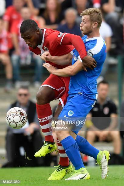 Obbi Oulare forward of Antwerp FC battles for the ball with Jakub Brabec defender of KRC Genk during the Jupiler Pro League match between Royal...