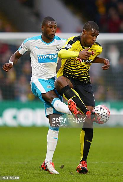 Obbi Oulare of Watford and Chancel Mbemba of Newcastle United compete for the ball during the Emirates FA Cup Third Round match between Watford and...