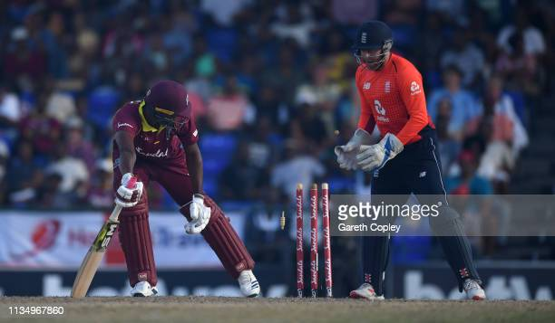 Obed McCoy of the West Indies is bowled by Adil Rashid of England during the 3rd Twenty20 International match between England and West Indies at...