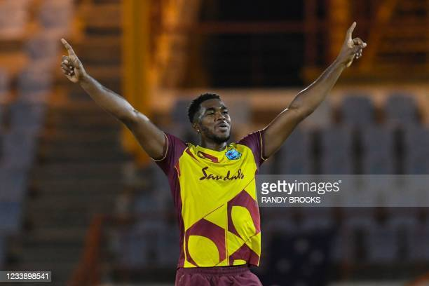 Obed McCoy of West Indies celebrates the dismissal of Mitchell Starc of Australia during the 1st T20I between Australia and West Indies at Darren...