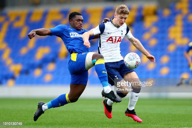 Obed Yeboah of AFC Wimbledon U18 challenges Matthew Craig of Tottenham Hotspur U18 during the FA Youth Cup Third round match between AFC Wimbledon...