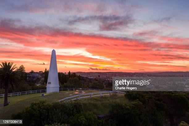 obelisk in newcastle, nsw at sunset - newcastle new south wales stock pictures, royalty-free photos & images