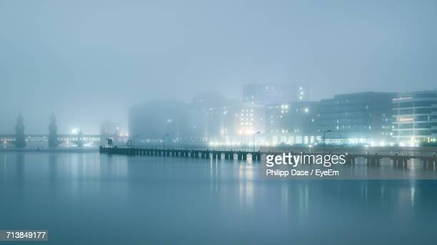 Oberbaum Bridge By Cityscape During Foggy Weather