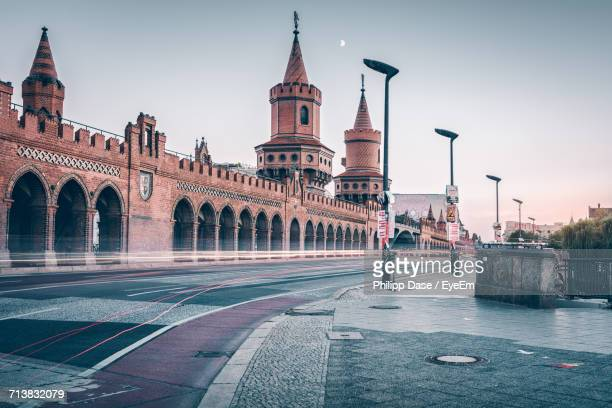 Oberbaum Bridge Over Spree River Against Clear Sky During Sunset