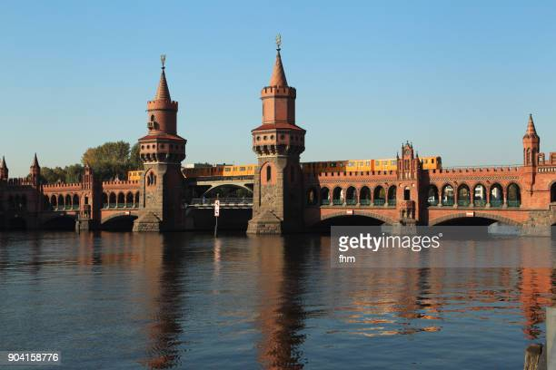 oberbaumbrücke in berlin with passing subway train (friedrichshain-kreuzberg, berlin) - friedrichshain stock photos and pictures