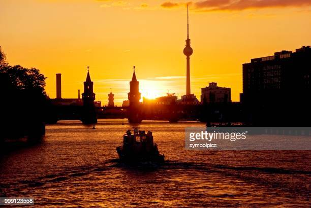 Oberbaumbruecke bridge, boat, sunset, Berlin, Germany
