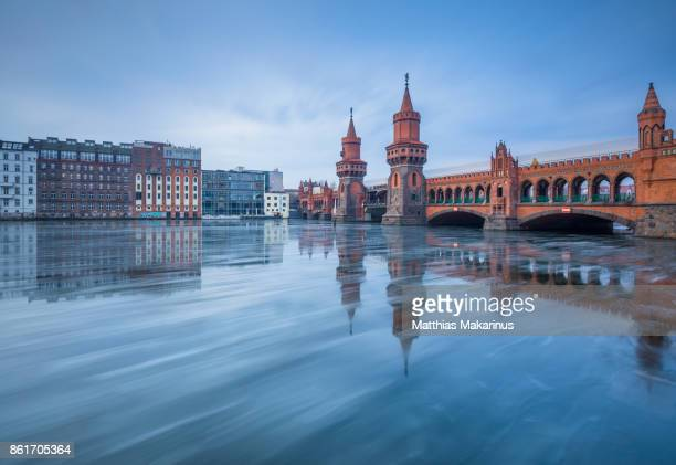 oberbaumbruecke winter berlin with frozen spree river - kreuzberg stock photos and pictures