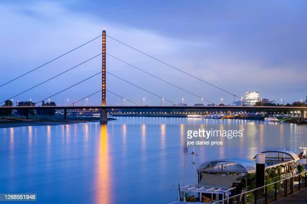 oberkasselerbrücke, road bridge, rhine river, dusseldorf, germany - messe düsseldorf stock pictures, royalty-free photos & images