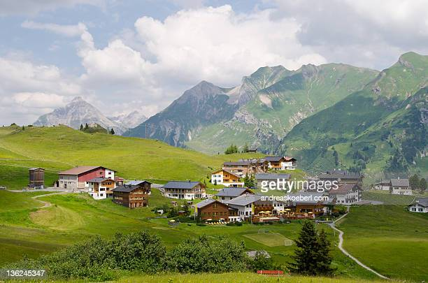 oberlech with mountains in  background - lech stock photos and pictures