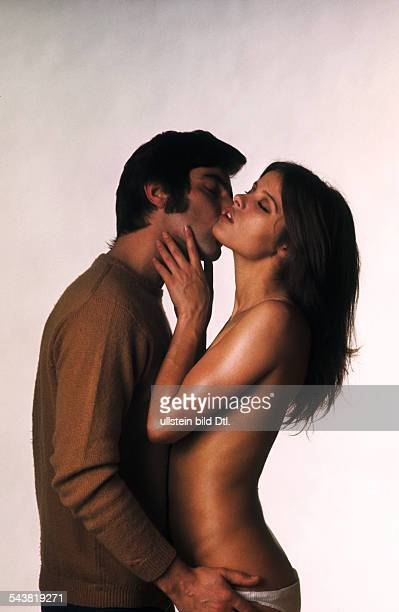 Obermaier Uschi * model actress Germany with a man kissinig her 1969