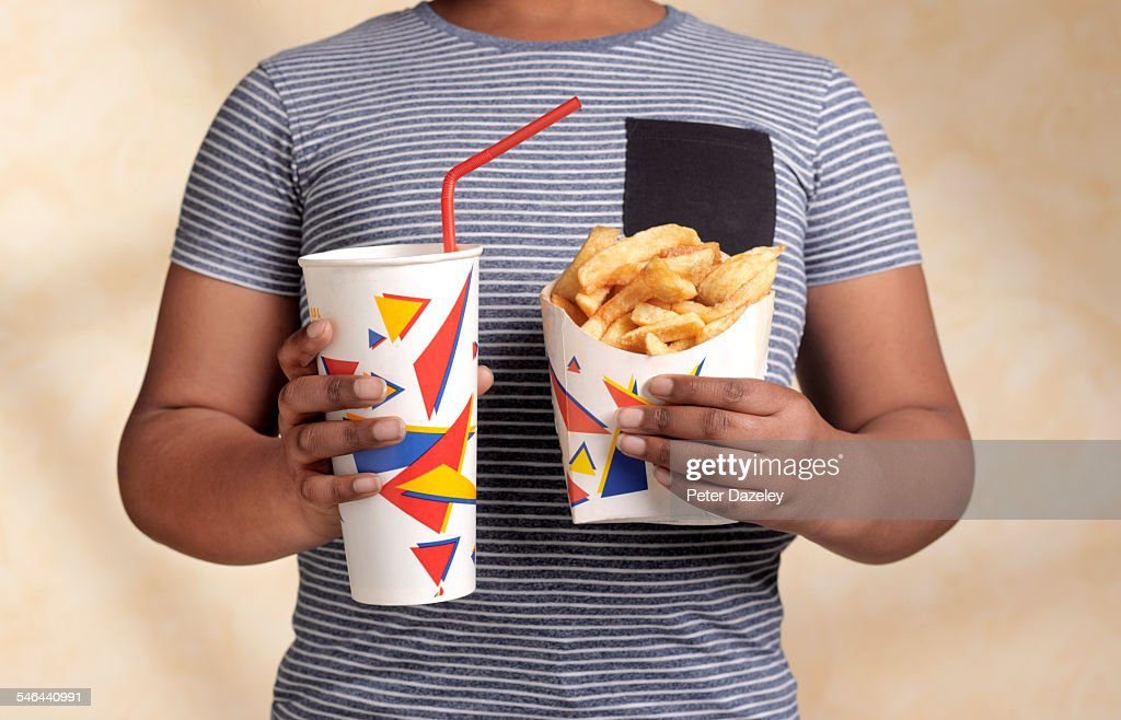 Obese boy with snack : Stock Photo