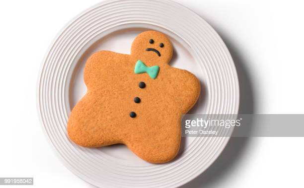 obese gingerbread man/woman - gingerbread men stock pictures, royalty-free photos & images