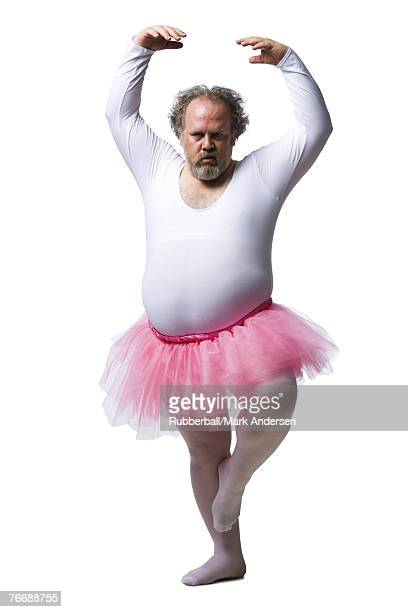 Obese man in tutu dancing