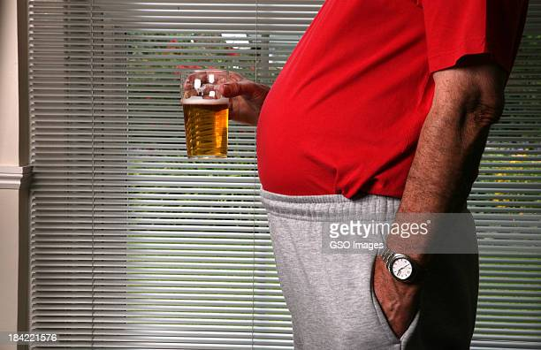 Obese man with beer in glass
