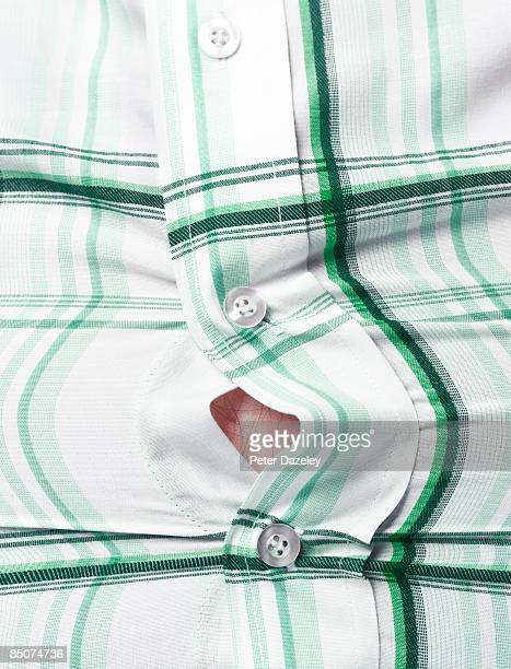 Obese man with shirt gaping open.