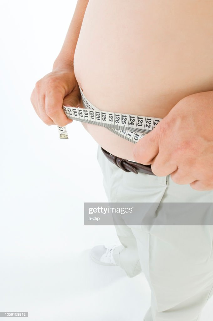 Obese Men Measure West In Major Stock Photo - Getty Images